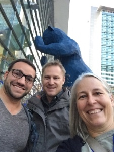 Photo: researchers posing in front of Denver's blue bear statue