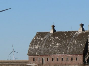 Photo: wind turbines next to an old barn and silo