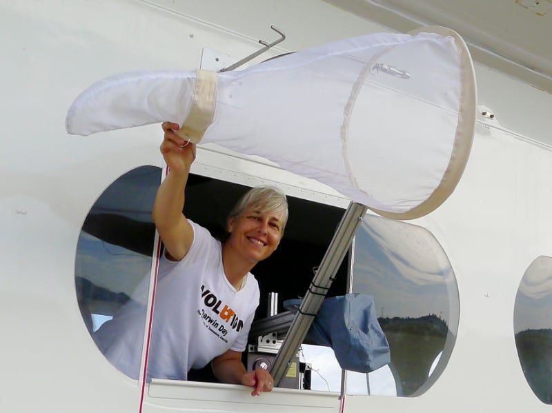 Photo: Jennifer Krauel and an insect net in the window of the BBC cloud lab airship.