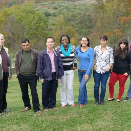Photo: Students from the conservation leadership seminar posing before fall colors